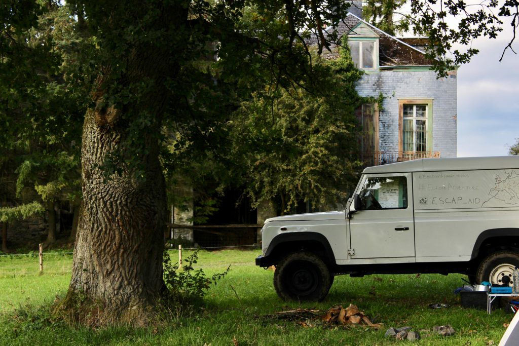 Land Rover at an abandoned house